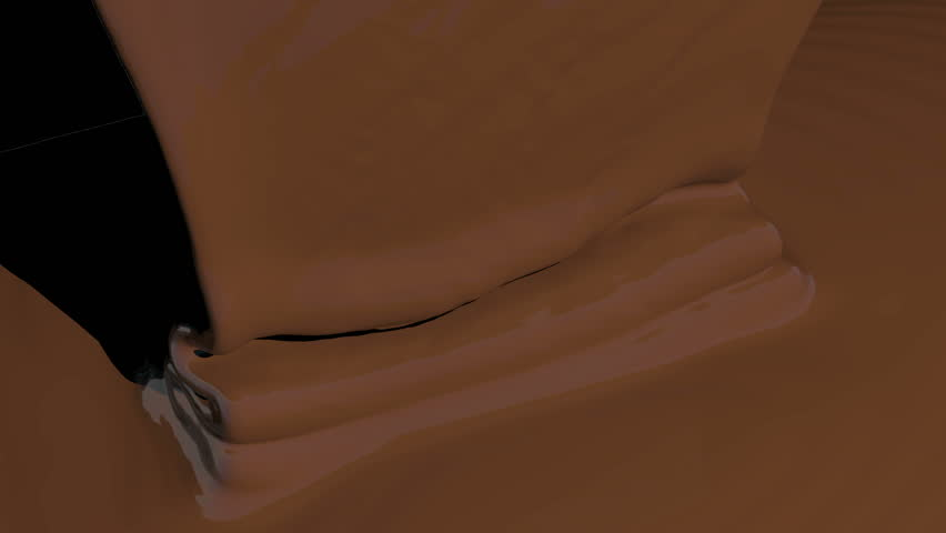 Chocolate flowing onto surface view from above. Comes with the Alpha Matte.l