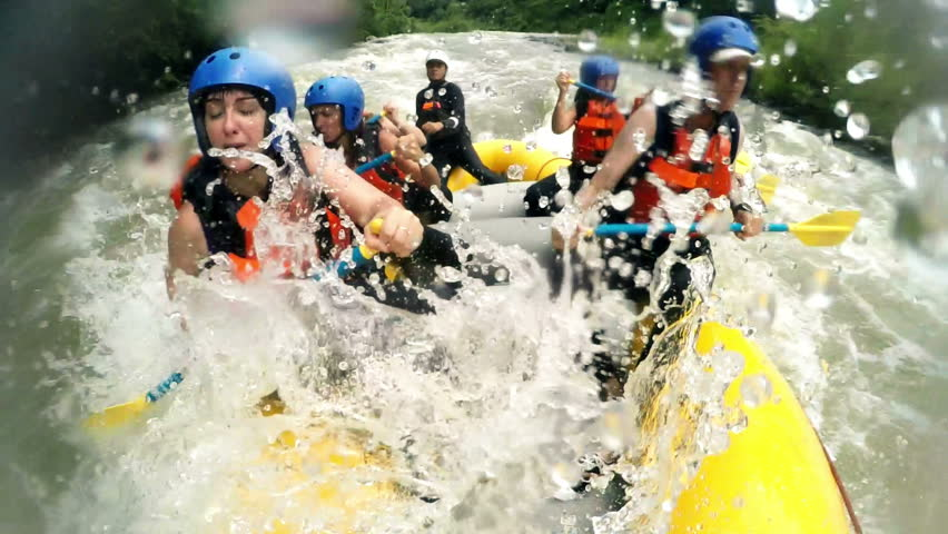 Immersive shot of rough whitewater rafting trip from onboard camera, slow motion 120fps | Shutterstock HD Video #10012394