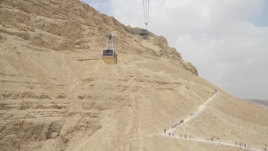 Masada Cableway. Cable car way to canyon and over the tourists.
