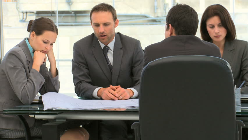 Business people working together on a document during a meeting in an office - HD stock footage clip