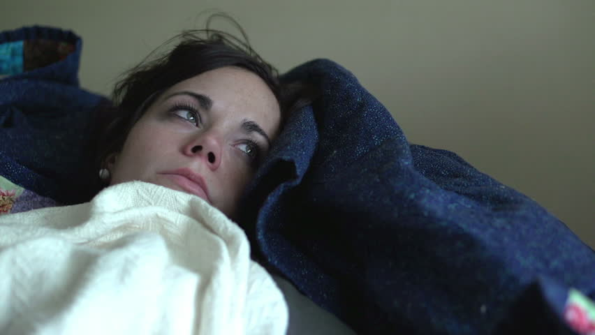 Girl with flu laying on couch sick - HD stock video clip