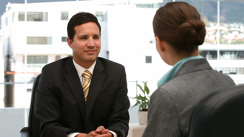 Interview between a man and a woman in an office