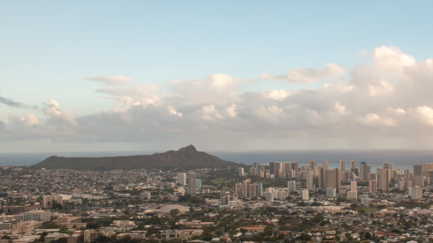 Long zoom out of sunset at Diamond head and Waikiki beach, Hawaii. Camera pans right - HD stock footage clip