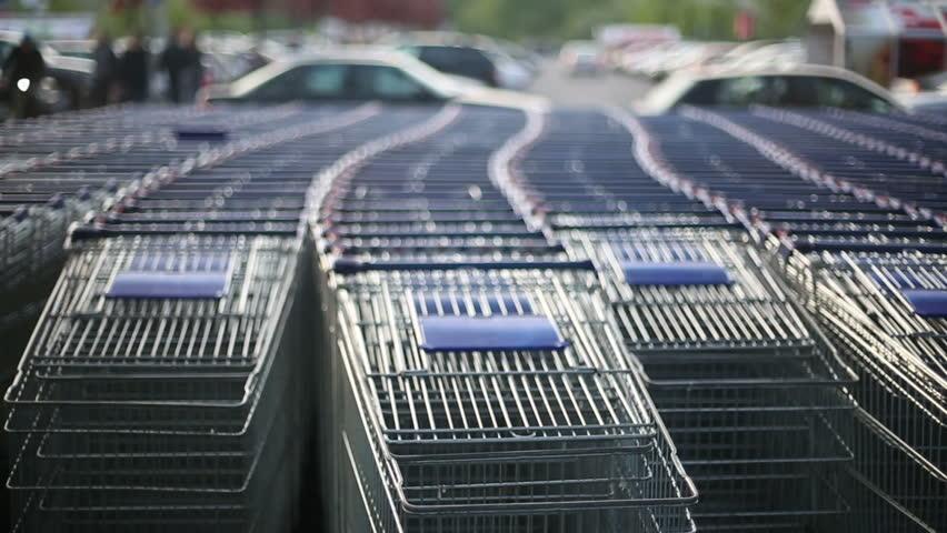 A lot of shopping trolleys near mall