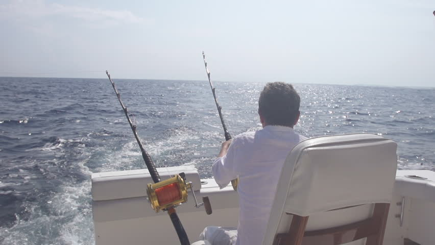 Slow Motion Rear View Of Man Getting Ready For Big Game Fishing On Open Sea | Shutterstock HD Video #10091522
