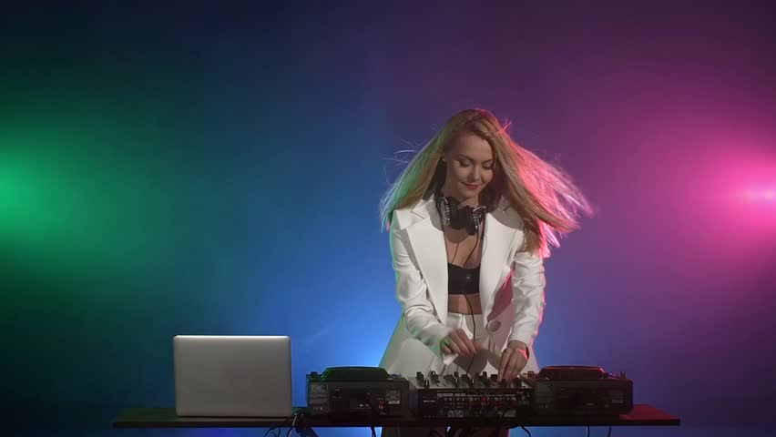 Sexy young beautiful blonde dj girl in white jacket for Beautiful house music