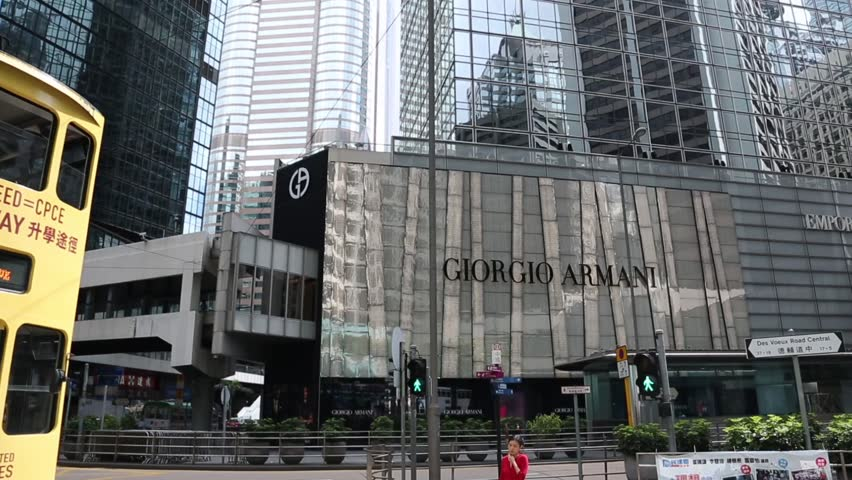 HONG KONG - CIRCA JUNE, 2014: District Central is the business district of Hong Kong Island. Hong Kong dynamic metropolis with a diverse architecture and old double-decker. Advertising GIORGIO ARMANI. - HD stock footage clip