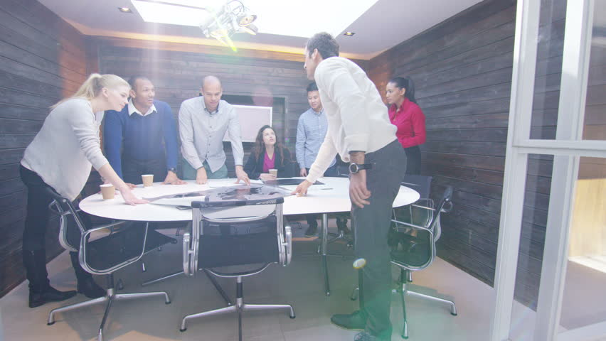 4K Attractive mixed ethnicity business team clapping in boardroom meeting