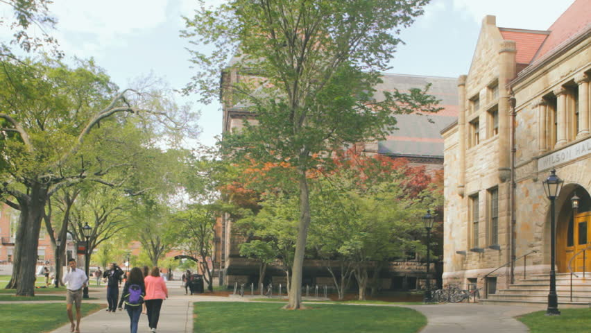 PROVIDENCE, RI - MAY 19: Students walk through Brown University college campus on May 19, 2015. Brown University is a private Ivy League research university in Providence, Rhode Island founded in 1764 - HD stock footage clip