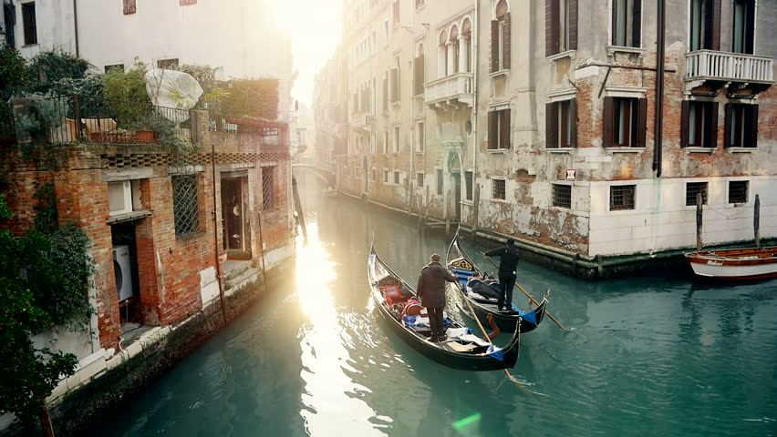 Magic drone shot of Venice with gondola in canal