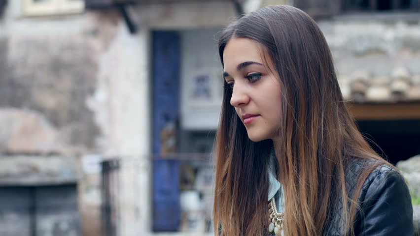 Pensive and sad young woman: teenager lost in her thoughts and problems | Shutterstock HD Video #10221824