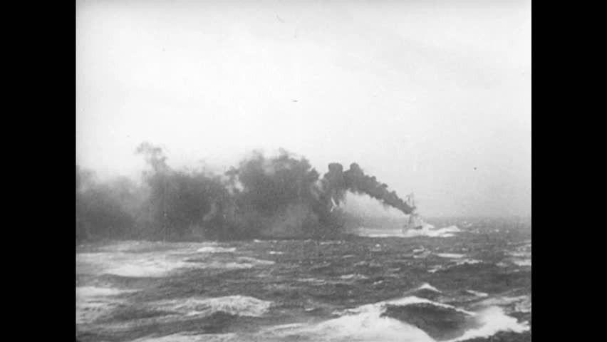 UNITED STATES 1940s: Ship on fire / Sailor signals with light / Sailor turns valve / Hatch closes / Submarine, camera submerge / Smoke on water / Explosions on water. - HD stock footage clip