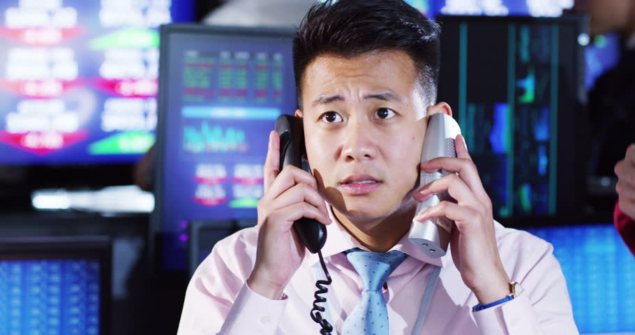 4K stressed city financial trader reacts as he watches the markets crash