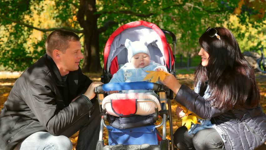 Young Happy Family with baby in a stroller - HD stock footage clip