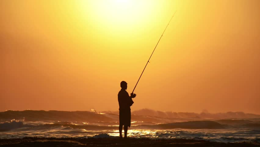 Fisherman in Sunset - HD stock footage clip