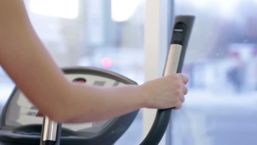 Young woman training in a gym closeup