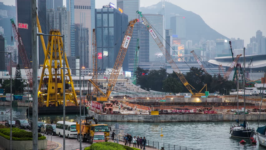 HONG KONG - CIRCA 2013: Time Lapse of Construction site and ship in action in Hong Kong