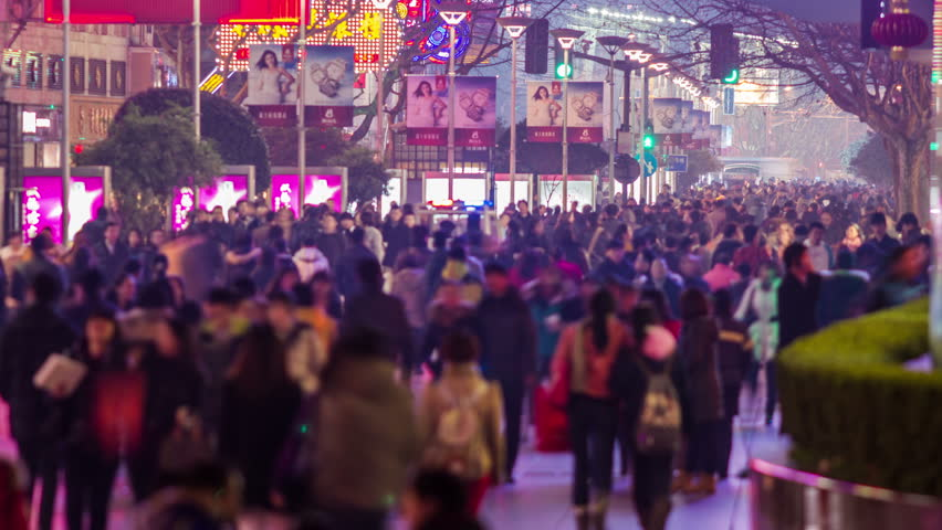SHANGHAI - CIRCA 2013: Time Lapse of anonymous crowds in Nanjing road in Shanghai, China at night