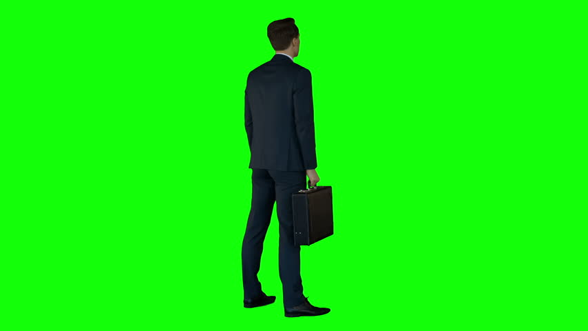 Businessman with suitcase looking around him in utra hd | Shutterstock HD Video #10337807