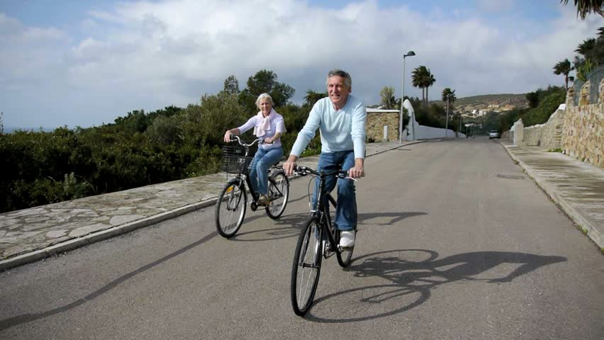 Senior couple riding bicycles