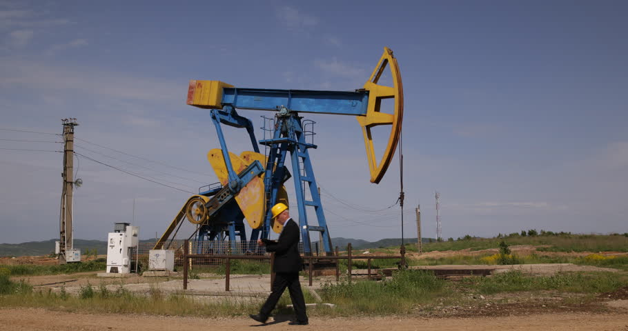 Engineer Management Experience Walk Thru Oil Pump Rigs Taking Notes Using Agenda ( Ultra High Definition, UltraHD, Ultra HD, UHD, 4K, 2160P, 4096x2160 ) - 4K stock video clip