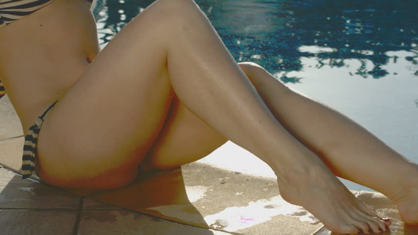 Sexy female lower body, woman enjoying her stay by the pool - 4K stock footage clip