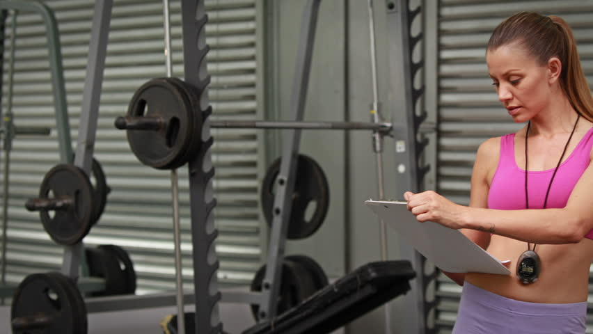 Trainer taking notes at crossfit gym in high quality 4k format | Shutterstock HD Video #10382195
