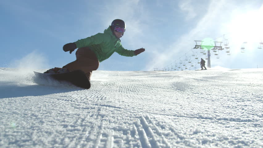 SLOW MOTION: Race snowboarder carving down the icy ski slope | Shutterstock HD Video #10394858
