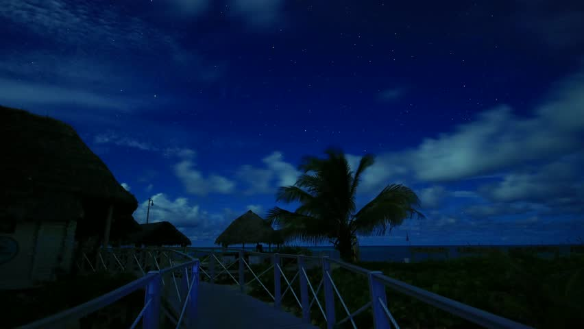 Tropical Beach Resort Lit By Moonlight At Night, Clouds ...