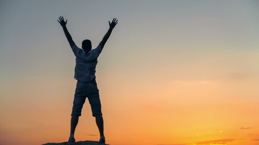 Success achievement running or hiking accomplishment business and motivation concept with man sunset silhouette celebrating arms up raised outstretched trekking climbing running outdoors in nature