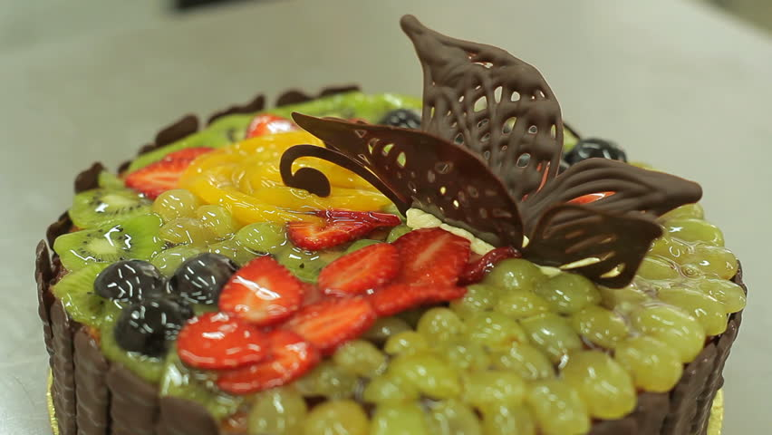 Cake Decoration With Kiwi Fruit : Cake Decorating. Close Up Of The Confectioner-baker Hands ...