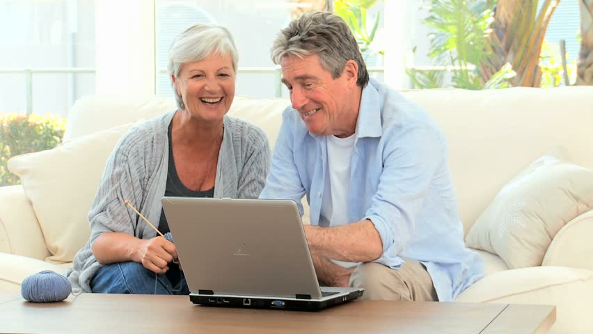 Senior couple looking at a computer - HD stock footage clip