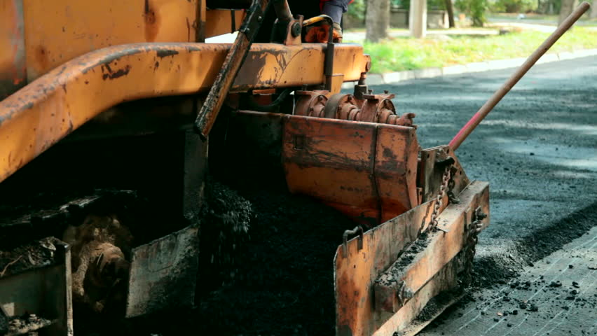 asphalt paving machine and road construction - HD stock footage clip