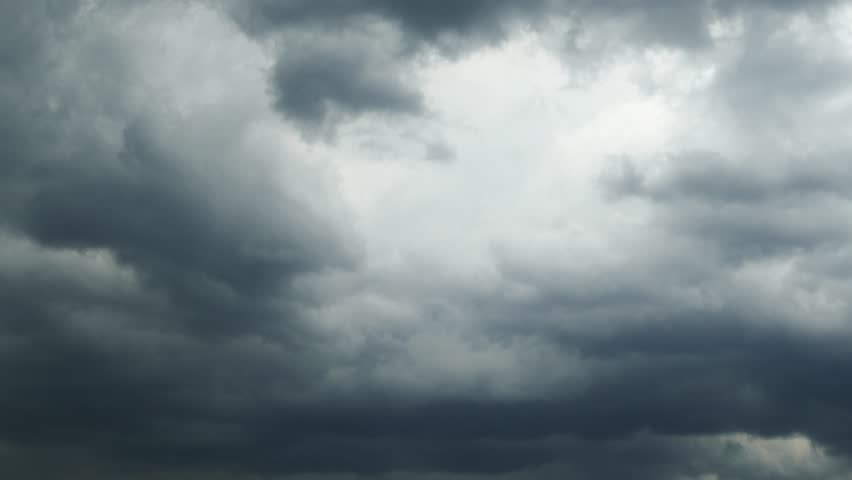 dark storm clouds are moving fast at viewer - timelapse 4k