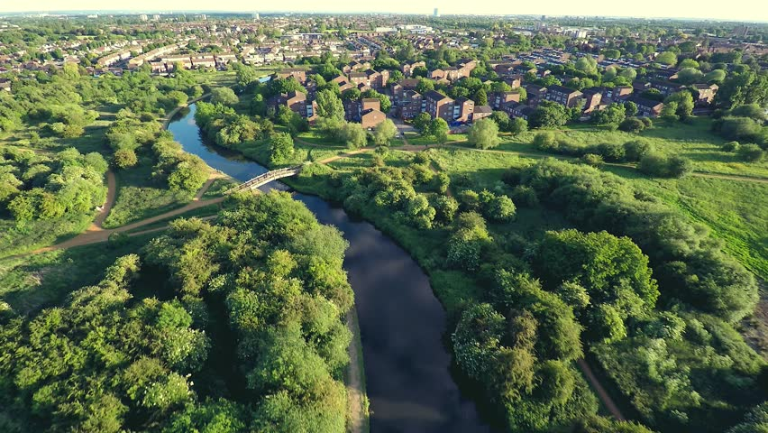 Aerial view over houses in English countryside