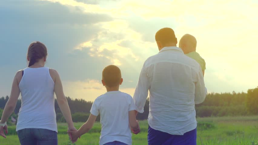 Happy Young Family with two children walking on summer field. Healthy mother, father and little sons enjoying nature together, outdoors. Slow motion 240 fps, high speed camera, Full HD 1080p  | Shutterstock HD Video #10502993