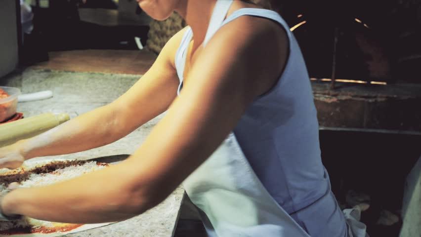 Female hands preparing pizza dough in restaurant. 4k - 4K stock video clip