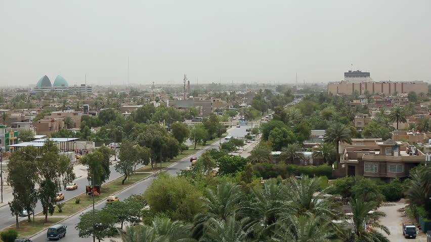 BAGHDAD, IRAQ - MAY 2015: Car traffic on Palestine Street in Baghdad, Iraq, pan left