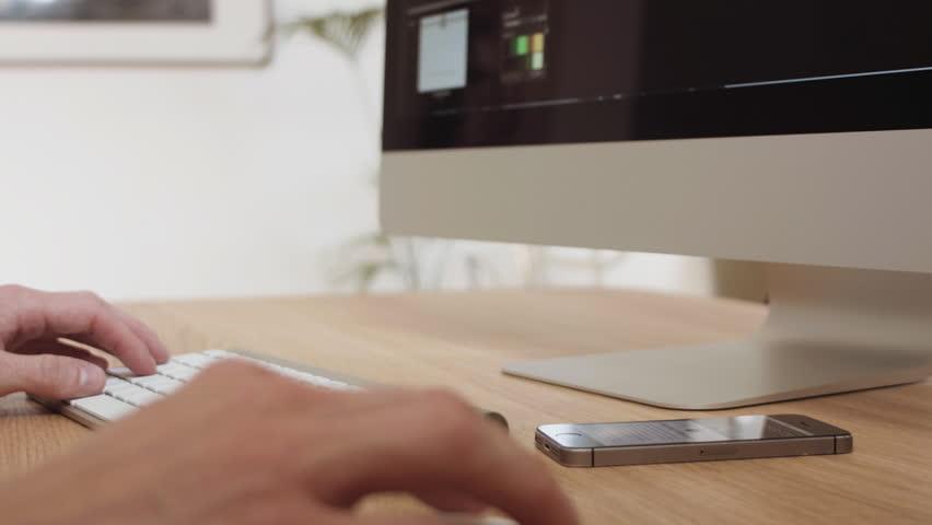 Web designer multitasking on a modern computer workspace