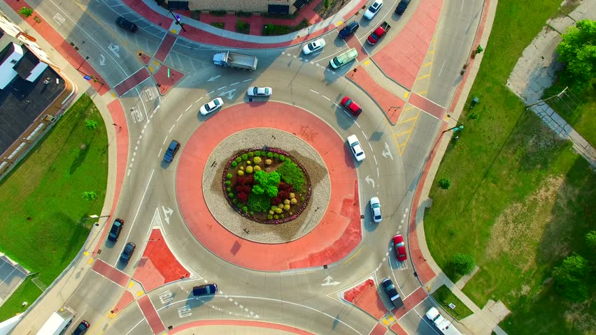 Scenic Aerial Time Lapse of Roundabout, Cars Speeding in Circle