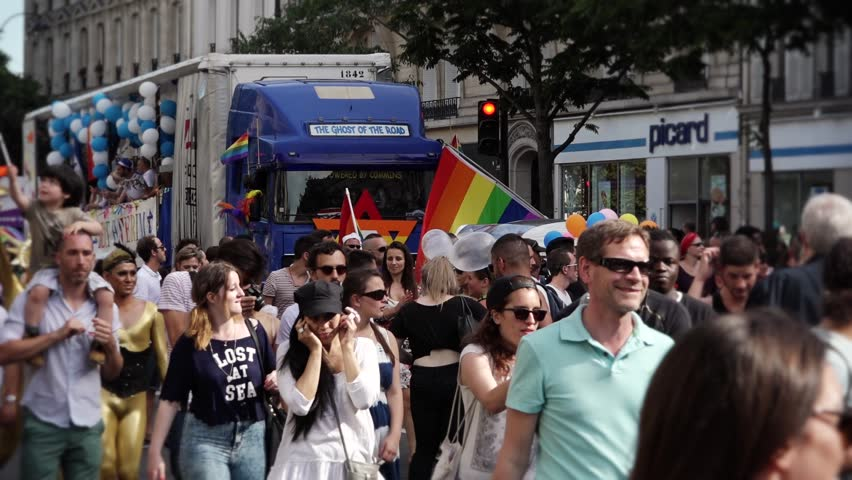 Gay Pride Protest Paris - 60fps. PARIS, FRANCE - 27 JUNE 2015; Gay pride or LGBT pride is the positive stance against discrimination and violence toward lesbian, gay, bisexual, and transgender. - HD stock footage clip