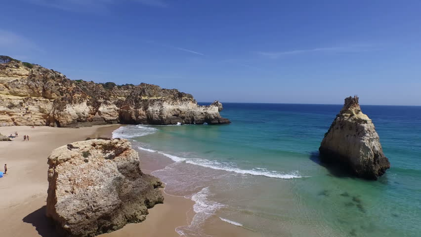 Aerial from natural rocks at Praia Tres Irmaos in Alvor Portugal   Shutterstock HD Video #10587602