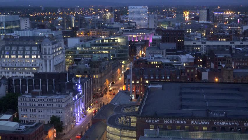 MANCHESTER - ENGLAND, MAY 28, 2015, ULTRA HD 4K Timelapse of city skyline and illuminated avenue at twilight