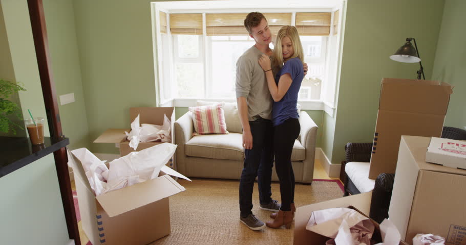 happy young couple moving into their new apartment stock footage video 10594154 shutterstock. Black Bedroom Furniture Sets. Home Design Ideas