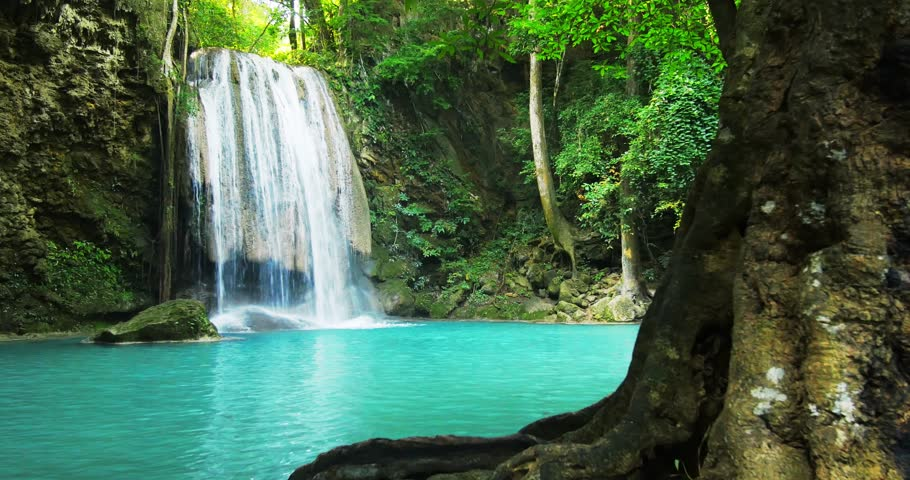 Paradise jungle forest with beautiful waterfall in green lush of Erawan park in Kanchanaburi, Thailand. Emerald pond and exotic plants | Shutterstock HD Video #10599545