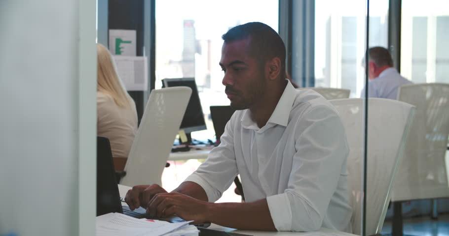 People Working At Desks In Modern Open Plan Office - 4K stock footage clip