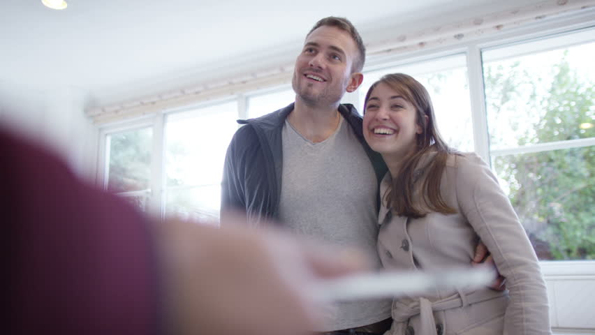 4K Young couple with real estate agent, looking at home to buy or rent   Shutterstock HD Video #10608248