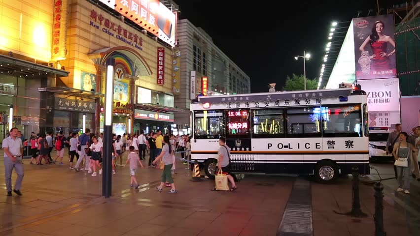 BEIJING - CIRCA JUNE , 2015: People on a pedestrian street Wangfujing in center of Beijing. Wangfujing one of the most famous shopping street in Beijing, is very popular among tourists and locals. - HD stock footage clip