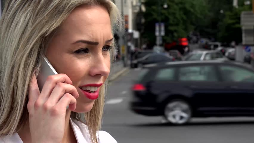 Young attractive woman phone with smartphone - urban street in the city with cars - closeup head | Shutterstock HD Video #10635302
