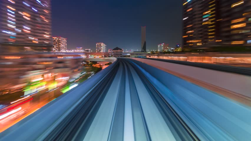 Point of view time-lapse through Tokyo tunnels via the automated guideway transit system (AGT) called the Yurikamome at night.  - 4K stock video clip